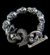 Skull On Snake With Skulls Links Bracelet