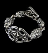 Sculpted Oval With 2 Lions & 2Skulls Bracelet