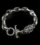 Half sculpted oval with half smooth anchor links bracelet
